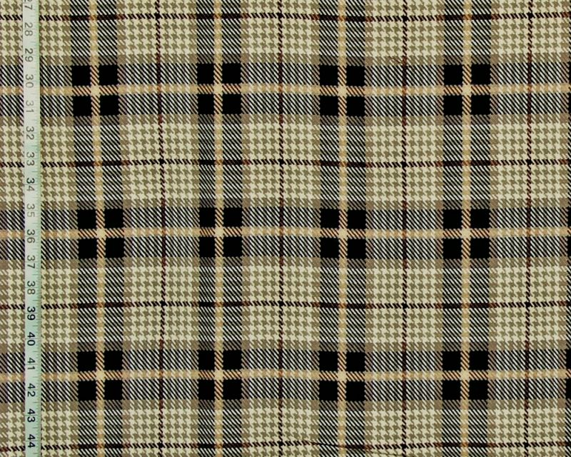 A traditional black and beige plaid fabric