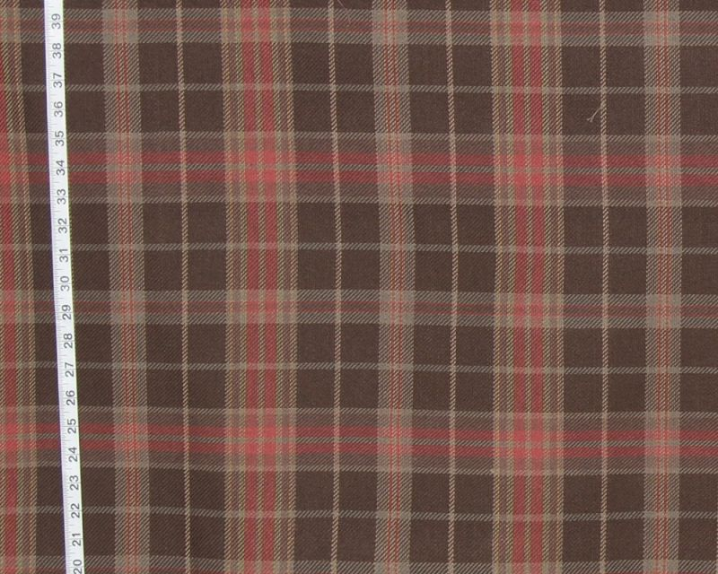 A traditional brown and red plaid fabric