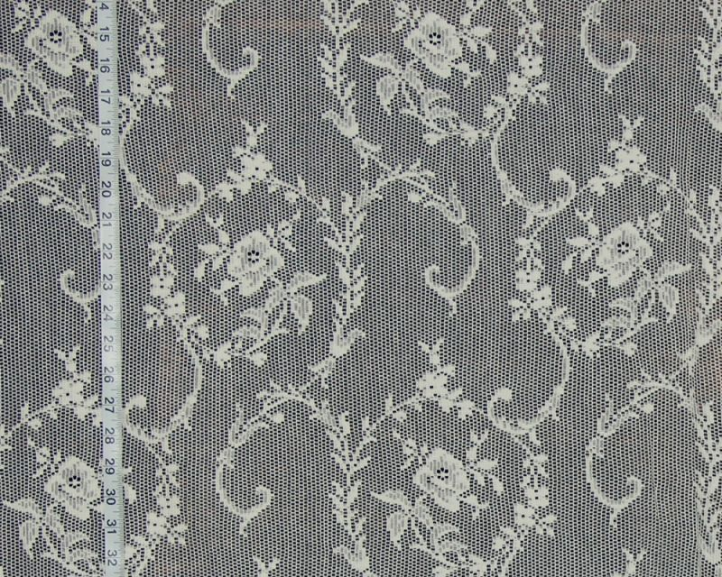 Scroll and rose Nottingham lace fabric